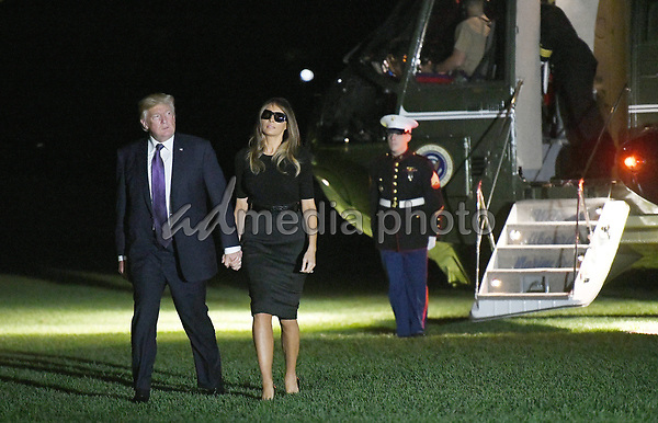 United States President Donald J. Trump and first lady Melania Trump return to the White House from Las Vegas, Nevada October 4, 2017. The President and the first lady visited with civilian heroes and first responders from the deadliest mass shooting in US history. Photo Credit: Olivier Douliery/CNP/AdMedia