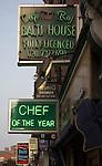 Neon signs for balti curry house restaurants Brick Lane, London, E1, England
