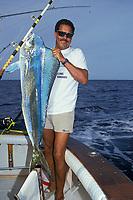 Charlie Murray with 25 lb 4 oz. mahi mahi, dorado or dolphin fish,Coryphaena hippurus, Cayman Angling Club Tournament Grand Cayman, British West Indies ( Caribbean Sea )