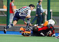 Stephane Vehrle-Smith (L) of Hampstead is denied by Brooklands keeper Lee Ible during the Mens Premier Division game between Hampstead & Westminster and Brooklands at the Paddington Recreation Ground, Maida Vale, London on Sat Feb 12, 2011