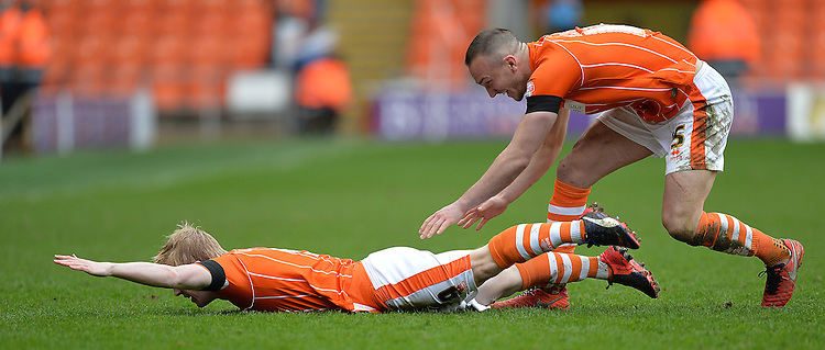 Blackpool's Mark Cullen celebrates scoring his team's opening goal with team mate Tom Aldred<br /> <br /> Photographer Dave Howarth/CameraSport<br /> <br /> Football - The Football League Sky Bet League One - Blackpool v Southend United - Saturday 2nd April 2016 - Bloomfield Road    <br /> <br /> &copy; CameraSport - 43 Linden Ave. Countesthorpe. Leicester. England. LE8 5PG - Tel: +44 (0) 116 277 4147 - admin@camerasport.com - www.camerasport.com