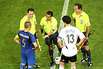 04 July 2006: Referee Benito Archundia (MEX) (center) conducts the pregame coin flip with captains Fabio Cannavaro (ITA) (5) and Michael Ballack (GER) (13). Italy defeated Germany 2-0 in overtime at Signal Iduna Park, better known as Westfalenstadion, in Dortmund, Germany in match 61, the first semifinal game, in the 2006 FIFA World Cup.