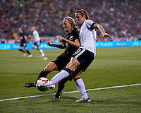Heather O'Reilly (9) of the USWNT has her cross blocked by Katie Hoyle (4) of New Zealand during an international friendly at Crew Stadium in Columbus, OH. The USWNT tiedNew Zealand, 1-1.