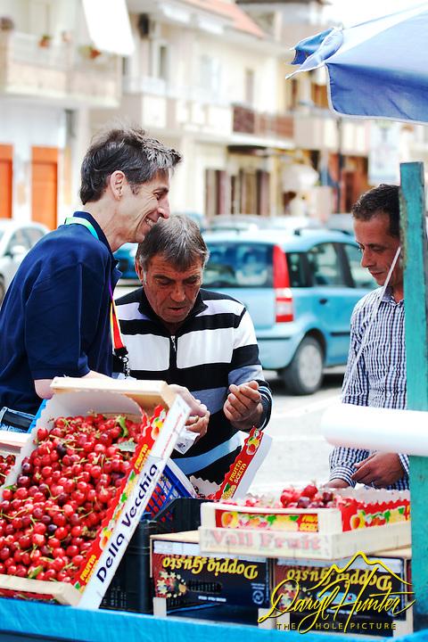 Professor Dan Petek buying cherries from a street vendor in Naples Italy