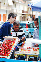 Professor Dan Petek buying cherries from a street vendor in Naples Italy