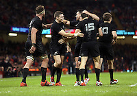 Pictured: Beauden Barrett of New Zealand (2nd L) with team mates celebrating his try Saturday 22 November 2014<br />