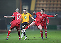 Conal Platt of Cambridge United is squeezed out by Nick Wright (l) and Keith Briggs of Kidderminster during the Blue Square Bet Premier match between Cambridge United and Kidderminster Harriers at the Abbey Stadium, Cambridge on 18th February, 2011 .© Kevin Coleman 2011.