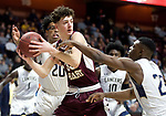 UNCASSVILLE, CT-031818JS08- Sacred Heart's Zachary Francisco (33) pulls down a rebound between Notre Dame-Fairfield's Noreaga Davis (20) and Josh Reaves (23) during their Division I championship game Sunday at Mohegan Sun Arena. <br /> Jim Shannon Republican-American