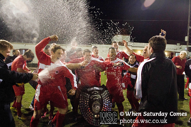 Walsall Wood FC 1 Atherstone Town 0, 02/05/2013. Oak Park, Midland Football Combination Premier Division. Walsall Wood players celebrating with champagne after being presented with the league trophy after their match with Atherstone Town at Oak Park. The club were crowned champions of the Midland Football Combination premier division the previous night due to results elsewhere, their first league win in 61 years. Walsall Wood, who were formed in 1915, won the match 1-0 watched by 69 spectators. The club's main stand is unique to English football and only one of two in the UK, the other being at Arbroath FC in Scotland. Photo by Colin McPherson.
