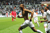 FAO: SPORTS PICTURE DESK<br /> Pictured: An ecstatic Darren Pratley of Swansea takes his shirt off celebrating the third goal of his team sealing their win. Monday 16 May 2011<br /> Re: npower Championship play-offs 2nd leg, Swansea City FC v Nottingham Forest at the Liberty Stadium, Swansea south Wales.