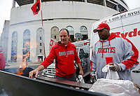 Gary Standard, 49, of Reyboldsburg, right, and Rick Lindeboom, 46, of Columbus man the grill at their tailgate prior to the NCAA football game against Rutgers at Ohio Stadium in Columbus on Oct. 18, 2014. (Adam Cairns / The Columbus Dispatch)