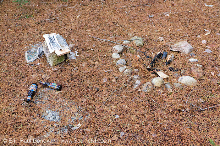 Poor Leave No Trace Ethics - Fresh firepit and campsite trash at Oliverian Brook Trailhead in the White Mountains, New Hampshire. The site was fresh in October 2011. And photographed in November 2011.