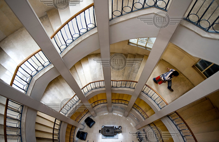 A staircase in the Bauhaus style Hotel Cinema Esther at 1 Zamenhof Strasse. It was built by architect Yehuda Megidovitz in 1939. Tel Aviv is known as the White City in reference to its collection of 4,000 Bauhaus style buildings, the largest number in any city in the world. In 2003 the Bauhaus neighbourhoods of Tel Aviv were placed on the UNESCO World Heritage List.