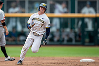 Michigan Wolverines outfielder Jesse Franklin (7) rounds second base against the Texas Tech Red Raiders in the NCAA College World Series on June 21, 2019 at TD Ameritrade Park in Omaha, Nebraska. Michigan defeated Texas Tech 15-3 and will play in the CWS Finals. (Andrew Woolley/Four Seam Images)