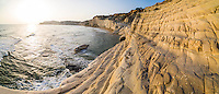 Panoramic photo of Scala dei Turchi at sunset, Realmonte, Agrigento, Sicily, Italy, Europe. This is a panoramic photo of Scala dei Turchi at sunset. Scala dei Turchi, aka The Turkish Staircase is a limestone cliff on the Rossello cape at Realmonte near Agrigento in Sicily, Italy. Scala dei Turchi is without a doubt one of the best spots in Sicily to watch the sunset.