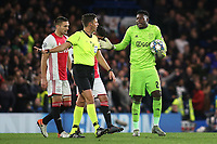 Referee Gianluca Rocchi explains to Andre Onana of Ajax that Var is checking whether Chelsea's fifth goal will stand during Chelsea vs AFC Ajax, UEFA Champions League Football at Stamford Bridge on 5th November 2019