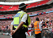 27th May 2018, Wembley Stadium, London, England;  EFL League 1 football, playoff final, Rotherham United versus Shrewsbury Town;  Police officer observing the Rotherham United fans from pitchside