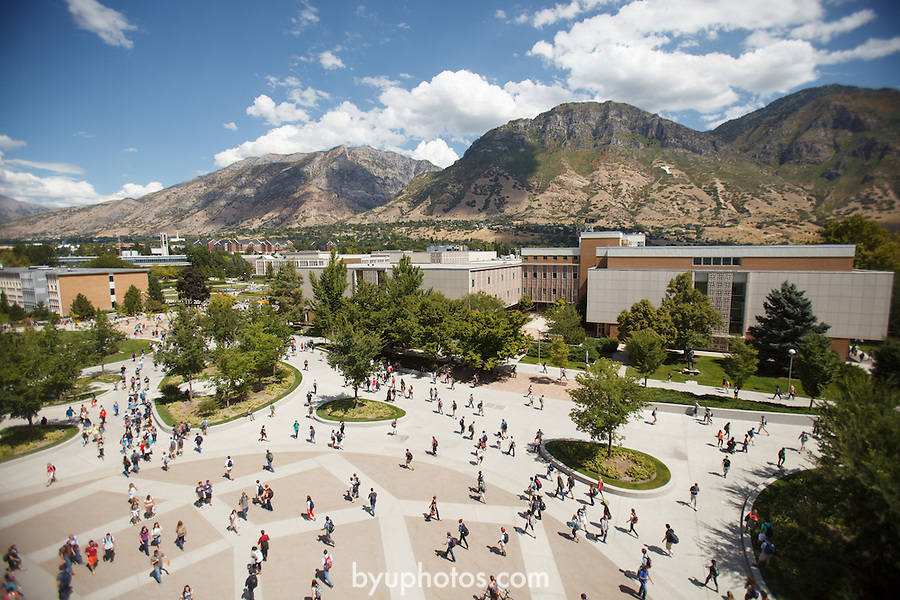1208-80 1540<br /> <br /> 1208-80 GCI First Day of Class<br /> <br /> Students walking in the JFSB Quad, HBLL in background, Sunny, Summer, Class Break, Shadows, Clouds, Overall.<br /> <br /> Photo by Jonathan Hardy/BYU<br /> <br /> August 27, 2012<br /> <br /> &copy; BYU PHOTO 2012<br /> All Rights Reserved<br /> photo@byu.edu  (801)422-7322