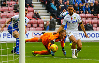 Leeds United's Kemar Roofe steals the ball after Wigan Athletic's Christian Walton fumbles<br /> <br /> Photographer Alex Dodd/CameraSport<br /> <br /> The EFL Sky Bet Championship - Wigan Athletic v Leeds United - Sunday 4th November 2018 - DW Stadium - Wigan<br /> <br /> World Copyright &copy; 2018 CameraSport. All rights reserved. 43 Linden Ave. Countesthorpe. Leicester. England. LE8 5PG - Tel: +44 (0) 116 277 4147 - admin@camerasport.com - www.camerasport.com