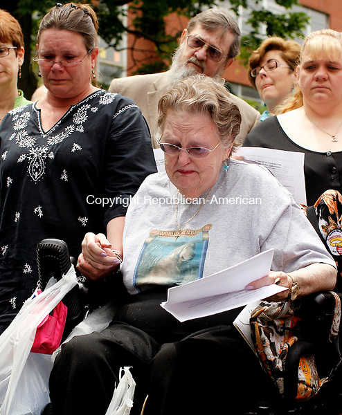 Waterbury, CT-22, May 2010-052210CM12  Jo-Anne Plunske watches as her long time friend and companion, Luke III is laid to rest on the green next to St. John's Episcopal church in downtown Waterbury Saturday afternoon. Luke III, a service dog, spent his life with her son, Michael and the remainder of his years with Plunske. --Christopher Massa Republican-American