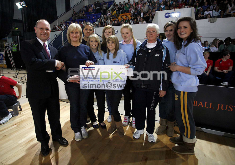 PICTURE BY Ben Duffy/SWPIX.COM - Netball - The Co-Operative International Series - England v Jamaica, Second Test - The Skydome arena, Coventry, England - 24/02/09...Copyright - Simon Wilkinson - 07811267706...Refugee cheque presentation