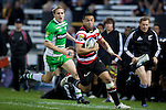 Casey Stone can only watch Sherwin Stowers sprint down the left wing.  ITM Cup rugby game between Counties Manukau and Manawatu played at Bayer Growers Stadium on Saturday August 21st 2010..Counties Manukau won 35 - 14 after leading 14 - 7 at halftime.