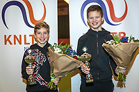Wateringen, The Netherlands, December 15,  2019, De Rhijenhof , NOJK juniors doubles , Final boys 12 years, winners Mees Röttgering (NED) and Hidde Schoenmakers (NED) (R) with the trophy<br /> Photo: www.tennisimages.com/Henk Koster