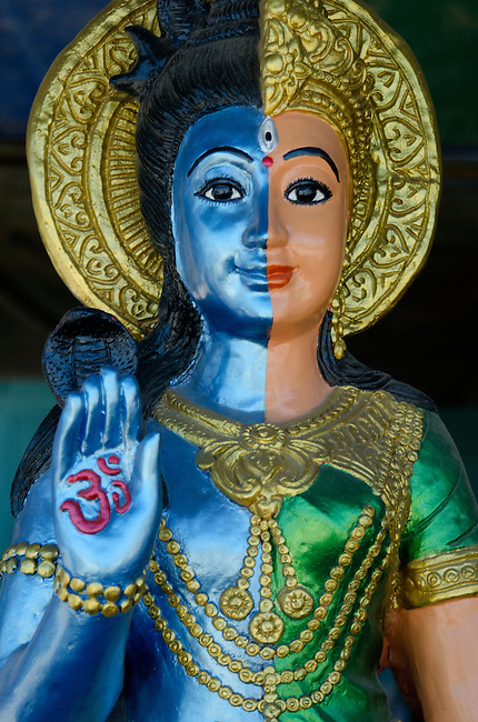 Hindu God statue with Om symbol on hand