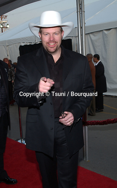 Toby Keith arrives at the 29th Annual American Music Awards at the Shrine Auditorium in Los Angeles Wednesday, Jan. 9, 2002.           -            KeithToby01.jpg