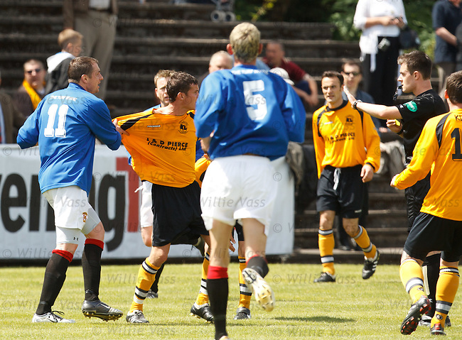 Tempers flare as Brian McGinty (L) is about to be sent off for a robust tackle