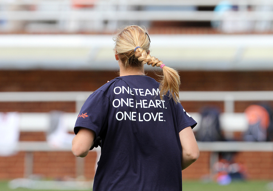 """The University of Virginia women's lacrosse team wore memorial t-shirt that said """"one team, one heart, one love"""" before their first game since the tragic death of teammate Yeardley Love Sunday May 16, 2010 at Klockner Stadium in Charlottesville, Va. The Cavaliers rallied in the last four minutes to beat Towson 14-12 and reach the quarter finals of the NCAA tournament. Love's body was found May 3, and Virginia men's lacrosse player George Huguely is charged with murder. Photo/Andrew Shurtleff..."""