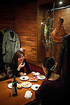 "Tokyo, december 2010 - At the restaurant ""La boucherie du Buppa"" in the Nakameguro area, specialized in meat courses. Two Japanese women eating meat and drinking wine. More and more Japanese women like to eat meat."