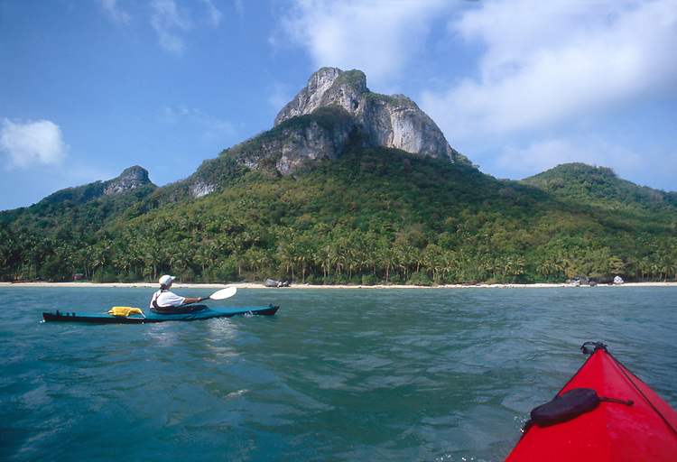Thailand, Kayaker in Ang Thong National Park, Gulf of Thailand, South China Sea, Susan Johnston, model released, Feathercraft breakdown sea kayaks,.