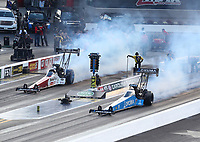 Oct 12, 2019; Concord, NC, USA; NHRA top fuel driver Clay Millican (left) alongside Leah Pritchett during qualifying for the Carolina Nationals at zMax Dragway. Mandatory Credit: Mark J. Rebilas-USA TODAY Sports
