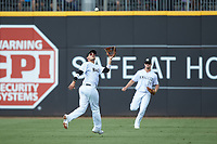 Charlotte Knights shortstop Ryan Goins (1) catches a fly ball in shallow left field during the game against the Gwinnett Braves at BB&T BallPark on July 14, 2019 in Charlotte, North Carolina.  The Stripers defeated the Knights 5-4. (Brian Westerholt/Four Seam Images)