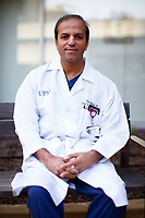 Dr. Abhi Humar poses for a portrait outside of UPMC Montefiore hospital on Friday April 17, 2020 in Pittsburgh, Pennsylvania. (Photo by Jared Wickerham/For The New York Times)