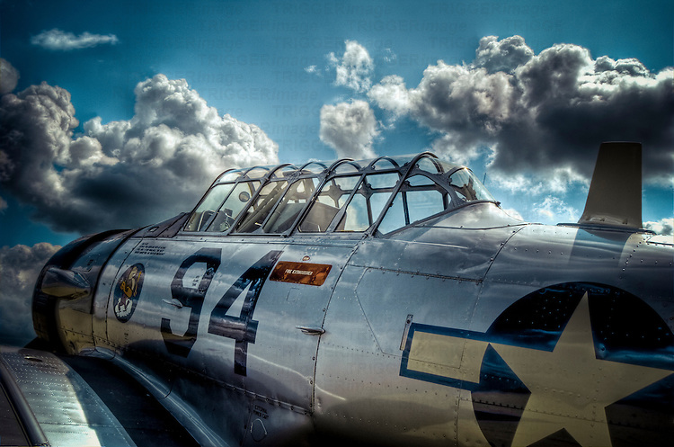 AT-6 Texan fighter aircraft from WWII with reflective metal work