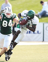 Jacob Wyatt (Defensive Back Eastern Michigan) intercepts a pass intended for Ohio 's Tight End David Carter. Ohio won their Homecoming Game 48 42..Eastern Michigan Football vs. Ohio University, 10 13 2007