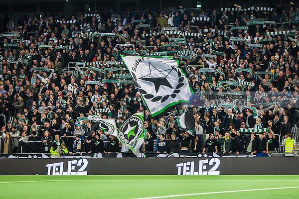 Stockholm 2014-03-04 Fotboll Svenska Cupen Hammarby IF - &Auml;ngelholms FF :  <br /> Hammarby supporter fans publik supporters med flagga och halsdukar p&aring; l&auml;ktaren <br /> (Foto: Kenta J&ouml;nsson) Nyckelord:  HIF Bajen &Auml;ngelholm