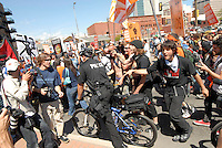 24 Aug 08: Protesters verbally accost a police officer riding a bike during a planned march from the Colorado state capitol building to the Pepsi Center. On the day before the Democratic National Convention is scheduled to begin about 1,500 people participated in the ReCreate 68 rally, which included a march from the Colorado state capitol building to the Pepsi Center.