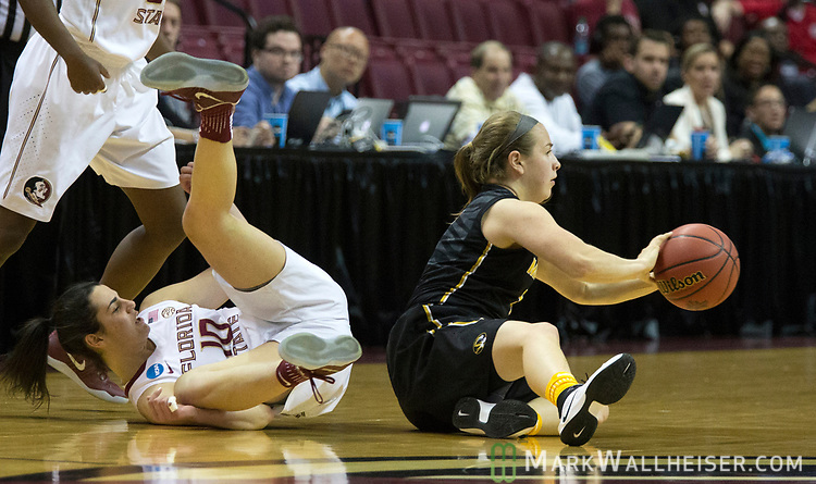 Missouri guard Lianna Doty passes the ball after coming up with a loose ball with Florida State guard Leticia Romero during the first half of a second-round game of the NCAA women's college basketball tournament in Tallahassee, Fla., Sunday, March 19, 2017. (AP Photo/Mark Wallheiser)