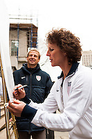 Former women's national team player Michelle Akers signs a document honoring the founding of the US Soccer Federation at a press conference honoring the centennial of U. S. Soccer at City Hall in New York, NY, on April 05, 2013.