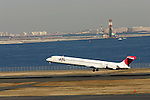 TOKYO - JANUARY 09: Japan Airlines (JAL) passenger aircraft takes off from Haneda Airport (HND) on January 9, 2010 in Tokyo, Japan. (Photo by Laurent Benchana/Nippon News)