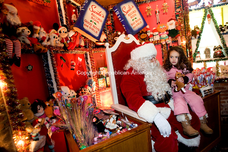 TORRINGTON, CT - 07 DECEMBER 2008 -120708JT06-<br /> Isabella Caruso, 3, of Torrington, visits with Santa Claus at Christmas Village in Torrington on the opening day on Sunday. The Christmas Village is a 61-year tradition, featuring Santa Claus, Mrs. Claus, an elves' workshop, Christmas carols, a nativity scene, and animals. The village is free, but long lines are common. <br /> Josalee Thrift / Republican-American