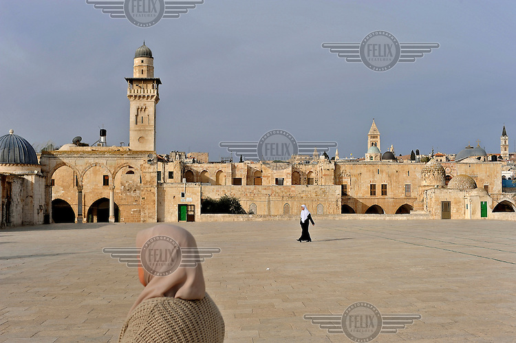 Muslim women walk in the Al-Aqsa Mosque compound on Temple Mountain, Jerusalem.