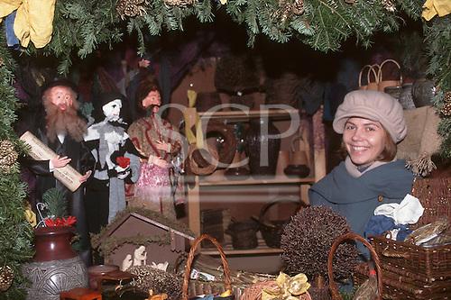 Krakow, Poland. Smiling young woman in a souvenir shop.
