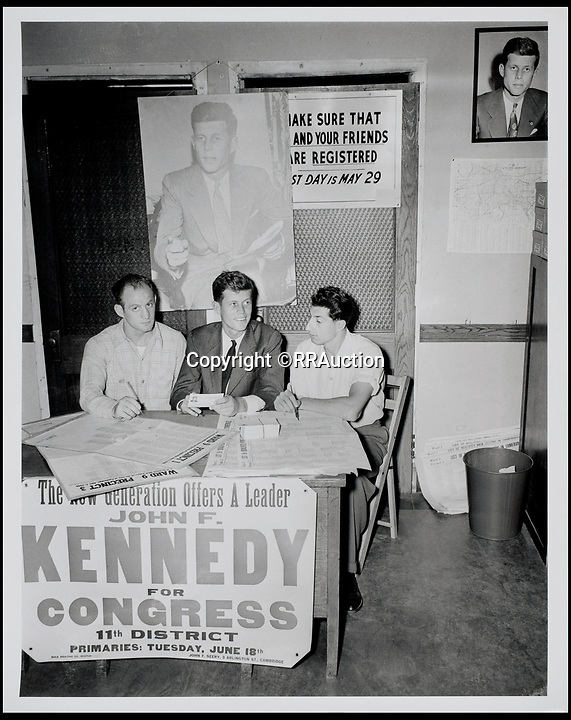 BNPS.co.uk (01202 558833)<br /> Pic: RRAuction/BNPS<br /> <br /> John F. Kennedy posing with two campaign workers, a banner below them reading: &quot;The New Generation Offers a Leader, John F. Kennedy for Congress, 11th District.&quot;<br /> <br /> Incredibly-rare photos highlighting the first foray into politics for John F. Kennedy that would eventually cost him his life have come to light.<br /> <br /> The 100 black and white snaps show a youthful-looking JFK from 1946, when he was campaigning to become a US congressman for the first time.<br /> <br /> The tragic future president is seen during an oration lesson where he was given help by an expert with public speaking and posture.<br /> <br /> The 29-year-old is also depicted mingling with the public at an annual parade and as well as celebrating his first political victory - a congressional primary vote - in June 1946.<br /> <br /> The images are being sold by US-based RR Auction.