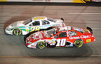 May 1, 2009; Richmond, VA, USA; NASCAR Nationwide Series driver Brian Scott (10) races alongside Kenny Wallace (28) during the Lipton Tea 250 at the Richmond International Raceway. Mandatory Credit: Mark J. Rebilas-