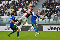 1st December 2019; Allianz Stadium, Turin, Italy; Serie A Football, Juventus versus Sassuolo; Filippo Romagna and Jeremy Toljan of Sassuolo challenge Cristiano Ronaldo of Juventus for a header - Editorial Use