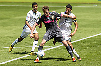 Leeds United's Patrick Bamford (centre) under pressure from  Swansea City's Ben Cabango (right) <br /> <br /> Photographer Andrew Kearns/CameraSport<br /> <br /> The EFL Sky Bet Championship - Swansea City v Leeds United - Sunday 12th July 2020 - Liberty Stadium - Swansea<br /> <br /> World Copyright © 2020 CameraSport. All rights reserved. 43 Linden Ave. Countesthorpe. Leicester. England. LE8 5PG - Tel: +44 (0) 116 277 4147 - admin@camerasport.com - www.camerasport.com